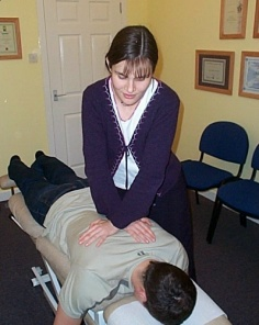 Alison treating a patient
